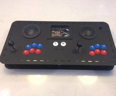"""Hi guys!In this Instructable I'll be walking you through a """"portable"""" 2 player arcade console build (designed from scratch). The idea is that it is mostly self-contained, with power, HDMI and USB plugs on the body of the console for ease of use- simply plug and play with the built-in arcade controls, or add your own via the 2 USB ports! This design uses Raspberry Pi running RetroPie (Emulation Station and Retroarch), which is very well documented on the web. So this inst..."""