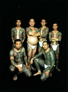 This is one of those famous photos of Yakuzas showcasing the traditional full suit tattoos... ok, this is real body art