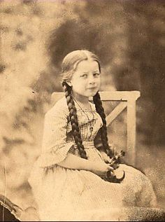 She's irresistable, and look how long her braids are! 1850s