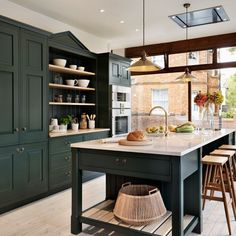 While the island is the mainstay of the modern-day, open-plan kitchen, the latest trend is for islands that have a more freestanding feel, often with tall legs and open shelving. Such pieces are long-serving additions in painted kitchens — think of all those stunning larder units. Here the lightness of the furniture allows for a dramatically dark colour scheme that is really elegant.