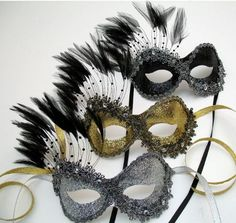 wedding favors maybe?  i don't know but i kind of like the idea of black and white venetian masks somewhere...