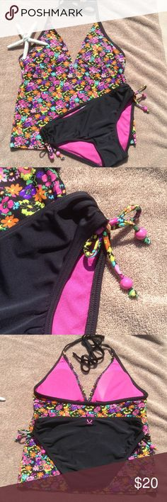 Floral Tankini Swimsuit Set This cute Tankini set has a floral print top that ties at the neck. Removable pads. Solid black bottoms have rouched sides with matching floral print ties. Beaded accents on the ties. 2Chillies Swim Bikinis