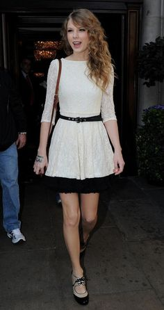Cheap Chic.......... Taylor loves sweet retro-inspired pieces from chip chic retailers like Topshop. She was spotted in the store's darling cream lace dress, which she belted and modfied with an exposed black tutu.