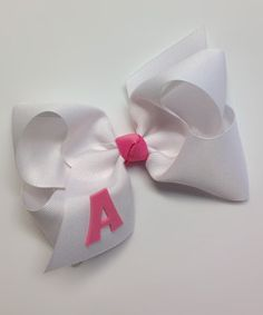 Decorate a 'do with this personalized bow! Crafted in the USA with loops of lovely ribbon, it's the perfect piece to complete an outfit.