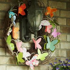 Butterfly Wreath~They used paper butterflies, but I'd use the weather-proof ones sold at craft stores.