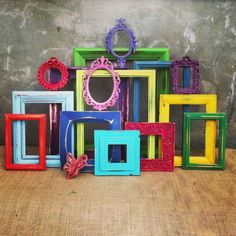 Fun, funky and whimsical ... coloured frames a friend of mine did this with her classroom art. I think it would be great in a playroom