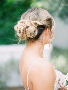 Braided low bun wedding updo: http://www.stylemepretty.com/2017/04/28/romantic-lush-arizona-wedding/ Photography: Rachel Solomon - http://rachel-solomon.com/