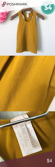$4 Clearance: Plz Read Description Pre-loved but still in good condition. Minor unnoticeable snags. Stretchy material. One size fits most (more suited for a small or medium.) 92% nylon, 8% spandex. Made in China. Color is a Dijon Mustard Yellow. Crew neck. Racerback. Lightly ribbed. Bundle this with other items to potentially get it free. Tags: summer work beach every day brown shirt top tank Tanco USA Tops Tank Tops