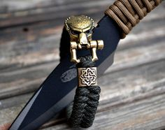 Hey, I found this really awesome Etsy listing at https://www.etsy.com/listing/579806063/paracord-bracelet-with-predator-brass