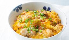 Spicy Oyakodon(Rice bowl with Egg and Chicken)ingredients (Serves 2) 200 g chicken thigh 1/2 onion 4 eggs 2 bowls cooked rice chopped green onion, for garnish chopped chili pepper, to taste  100 ml water 2 tsp gochujang (Korean chili paste) 2 tbsp sugar 4 tbsp sake 2 tbsp soy sauce