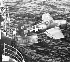 A U.S. Navy Grumman F6F-3 Hellcat fighter of fighting squadron VF-2 being catapulted from the aircraft carrier USS Hornet (CV-12) via the hangar catapult, 25 February 1944.