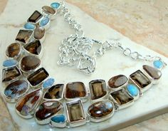 Beautiful item with Agate, Smokey Quartz, Fire Opal Gemstone(s) set in pure 925 sterling silver.