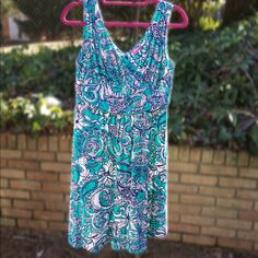 Lilly Pulitzer Shianne V-Neck Dress This is a beautiful beach/summer dress. It flows nicely and is a stretchy as well. The dress has been worn about 10 times. $70 or best offer, no trades. Lilly Pulitzer Dresses Midi