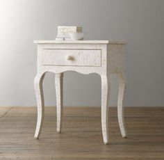 RH baby&child's Amira Mosaic Side Table:Meticulously crafted by hand in the traditional manner, our Amira Mosaic collection's delicate tonal mosaic celebrates the ancient art of bone inlay.
