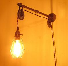 Industrial Pipe Wall Sconce Pulley Lamp w Bulb Cage - Distressed Steampunk Lighting