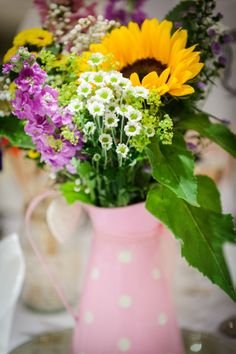 Pixies in the Cellar: Tiny Summer Wedding. Rustic table flowers in multicoloured jugs.