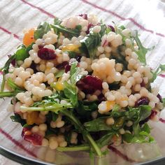 Citrus Couscous Salad! 3 oz arugula, 1/3 c chopped red onion, 5 oz dried cherries, 1 can mandarin oranges, 9 oz box Israeli Couscous, cooked, cooled, and lightly salted, 1.5 lbs of diced, cooked chicken seasoned with salt, pepper, and lemon to taste (optional) Dressing: -1/4 c white vinegar, 1/2 c olive oil, 1/3 cup fresh OJ, 3 Tbsp lemon juice, s&p, garlic powder. Combine all salad ingredients. Mix in the dressing and refrigerate for 2-3 hours to allow dressing to soak in.