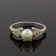 Antique Diamonds and Pearl Engagement Ring in 14k White Gold. I love the idea of pearls on an engagement ring.