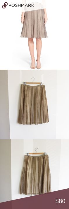 Batiste Flirt Skirt, Nic + Zoe Raised seams texture the length of a gently flared A-line skirt cut from a soft, sheer batiste for fluttery, feminine movement. New without tags. Color is Mushroom. NIC + ZOE Skirts Midi