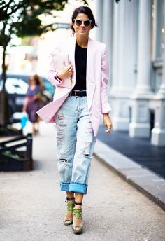 Leandra Medine rocks her distressed jeans with bright green heels and a oversized pink blazer