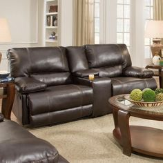 This reclining loveseat features two extra large seats for laying back in comfort. It is covered in a comfortable brown upholstery and has soft cushions for sinking into. This affordably priced sofa will give your living room or family room a fresh, casual style.