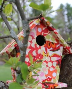 Wooden Birdhouse from fabric scraps, outdoor Mod Podge, Krylon clear spray paint.  This looks like a good craft to do with the grandgirls :)