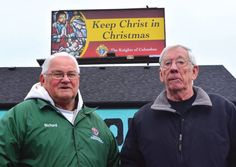 "Richard Fron, left, and Owen Grant, current and past grand knights, respectively, of the Fr. Patrick O'Kelley Council 3860 in Dearborn, stand near a billboard on Telegraph Road in Dearborn Heights reminding drivers to ""Keep Christ in Christmas."" The Knights of Columbus purchased 10 such billboards throughout Metro Detroit for the month of December."
