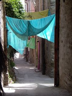 enjoy the shade in the tiny village of Bevagna in Umbria, Italy