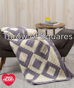 Throw of Squares Free Crochet Pattern in Red Heart Yarns -- Positive-negative crochet square motifs in just two colors are sewn together in diagonal strips for this striking throw. Side and corner triangles fill in the edges and then a simple border is the perfect finish.