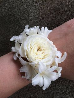 modern elegant all white wrist corsage flower cuff peterkort spray roses white hyacinth blossoms  http://sophisticatedfloral.com/