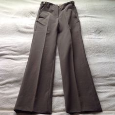 """Burberry Prorsum High Waisted Straight Leg Pants Doesn't look like much in pics but MAN does this look amazing on!!! Impeccable tailoring! Structured fabric, fully lined, quite substantial. High waisted fit. Button tabs on sides, pockets in front. Burberry label and care tag in tact. Fits smaller than size indicates! Fits more like a 0-2! Best for a 26"""" waist or smaller and labeled as such although tag says US 4.  I'm a 27"""" waist and it still fits (a bit tight). Excellent condition. Burberry…"""