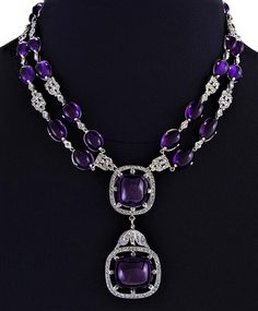 An Art Deco diamond and amethyst necklace set in 18 karat white gold. The necklace's double chain is comprised of a repeating pattern of white gold diamond studded plaques and cabochon amethysts. Gold Rings Jewelry, Amethyst Jewelry, Amethyst Necklace, Bridal Jewelry, Diamond Jewelry, Antique Jewelry, Amethyst Pendant, Jewelry Necklaces, Jewellery