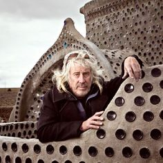 """Michael Reynolds created and develops Earthships. He originally bought land, sold it largely """"will - earn"""", teaching as they built their own homes, and learned his ideas. No mortgages, no licenses, no bondage! Teaches sustainability. Turn key minds shut him down, took his architect's license, tried to force him into the System. He went instead to the poor of the world, those in need & helps them?"""