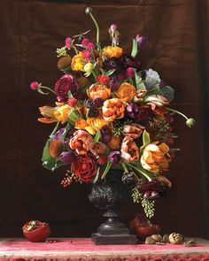 Take a cue from classic Dutch painters and create a floral display that's as captivating as an early-17th-century still life by Jacques de Gheyn or Ambrosius Bosschaert the Elder. Tulips and ranunculus anchored many of their compositions, so we've paired those flowers with other blooms in autumnal oranges, purples, and reds. The insects are another nod to the old masters, who viewed them as symbols of transience.Conical: A cone-shaped florist's foam facilitates this display. We left the…