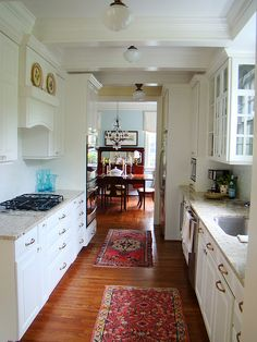 Galley Kitchen Design | I like the glass cabinet with glass on the side