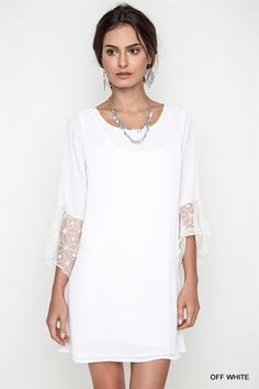 Perfect dress for your up coming event! Made with fabric that is soft and lightweight. Featuring three quarter bell sleeves with beautiful lace trim detail. Works wonderfully with any pair of your fav