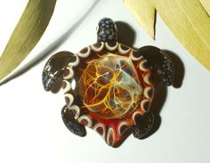CLUSTER FILAMENT SHELL - FLAMEWORKED TRIBAL TURTLE