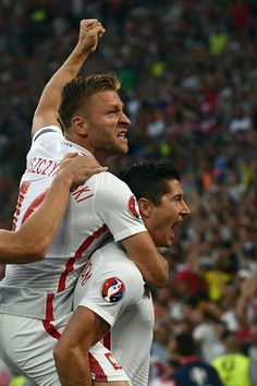 #EURO2016 Poland's forward Robert Lewandowski celebrates with Poland's midfielder Jakub Blaszczykowski after scoring the first goal during the Euro 2016...