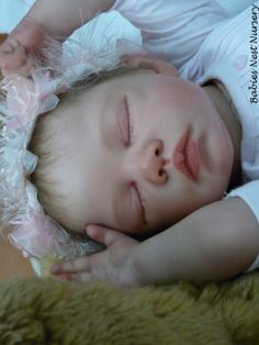 reborn baby doll created Andrea at Birds Nest nursery Portugal