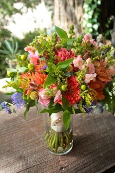 A more laid back look at the same flowers: dahlias, astillibe, echinacea, etc