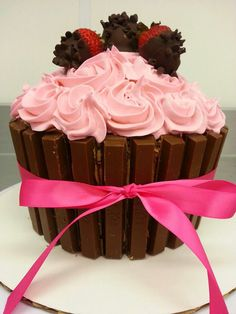 My Chocolate Dipped Strawberry Giant Cupcake made even prettier with a Kit Kat Border and a pretty pink bow!