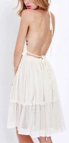 Show off that beautiful back with this white pleated dress.