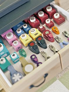 Never thought about the non-slip liner ---The Ultimate Scrapbooking Room: Punch It Out - Low-cost nonslip drawer liners prevent punches from shifting around in Polly's tool station. // This is something I would never have thought to do, but it's bang on!