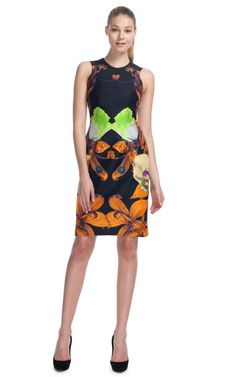 This sleeveless flower brocade sheath dress features a multicolor orchid print, darts at bust, seaming details, and a straight skirt   Exposed back zip 100% silk