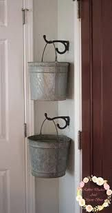 Cute way to hang galvanized pails. I would add some flowers or moss to give it an added rustic, farmhouse touch.