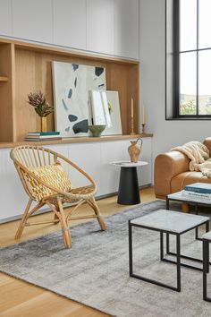 If you're not yet a rattan convert, the Livia is here to sway you #LivingRoomDecor #ModernLivingRoom #RattanChair #HomeDecor #InteriorDesign #Boho