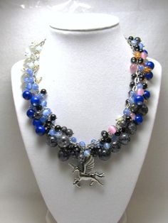 Pegasus Against the Storm - Jewelry creation by Linda Foust