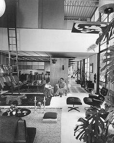 Charles and Ray Eames in the house they built known as Case Study House No. 8.