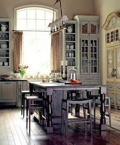 Love the mix of cabinets, the height of the cabinets and the patina of everything!