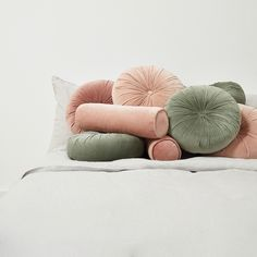 Lulu & Georgia Sabine Velvet Bolster Pillow, Rosewater pillow on bed Sabine Velvet Bolster Pillow, Rosewater